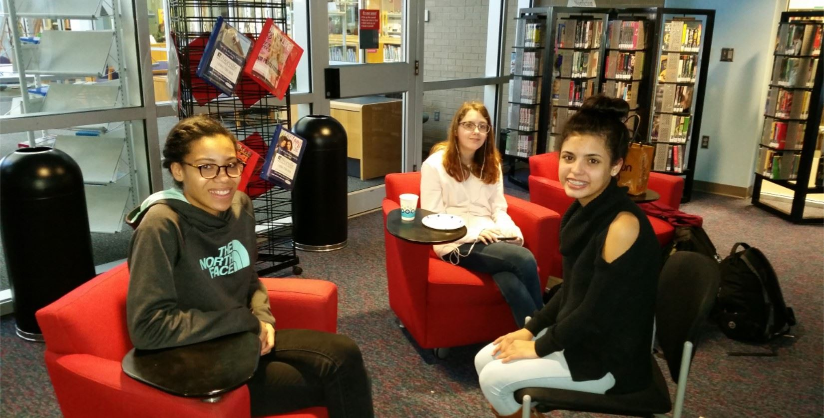 Friends relax after school in the Teen Space